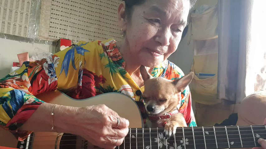 The ultimate definition of #LoveYourPetsDay is Malinda singing to her tiny little pup: