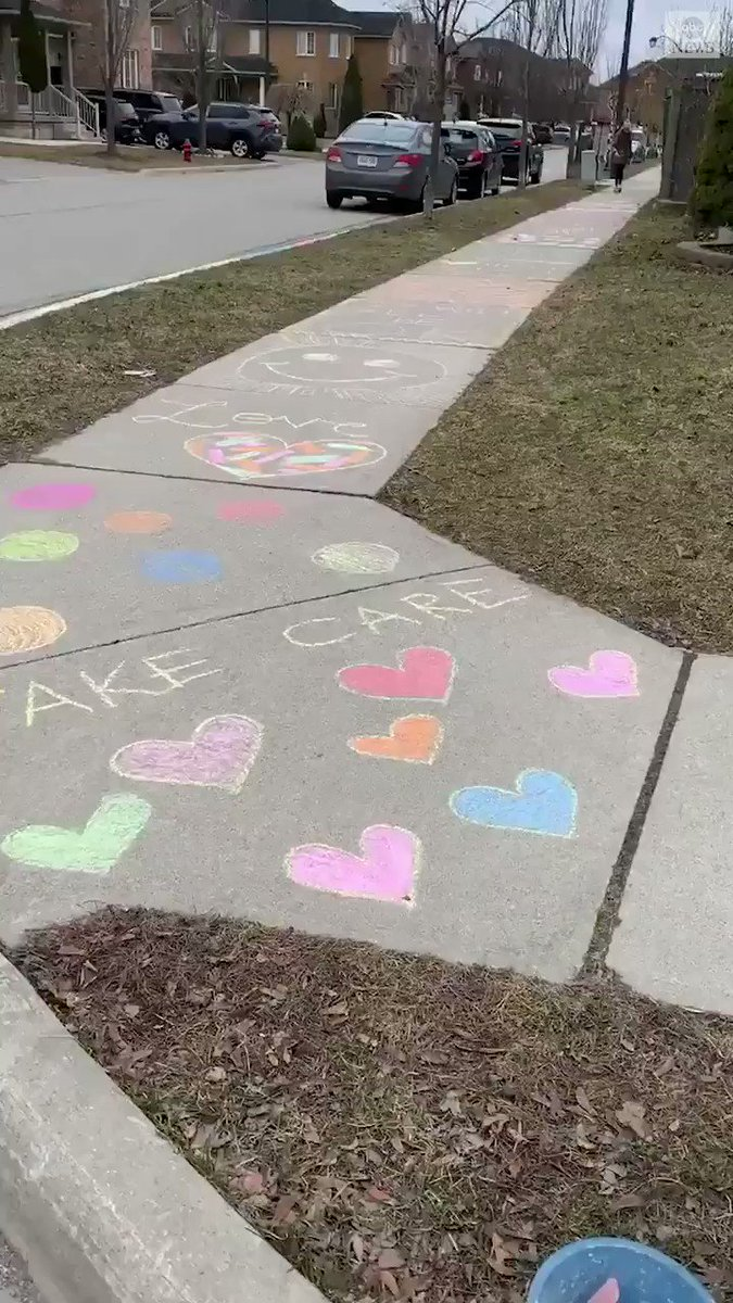 """""""It will all be OK.""""  """"Share, help and love.""""  """"Clean hands, open minds, warm heart.""""  This Ontario girl only needed chalk and a sidewalk to spread messages of happiness and positivity to her community."""