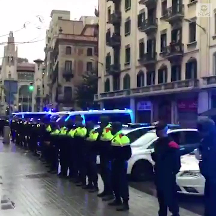IN TRIBUTE: Police in Barcelona paid tribute to their colleague who was reported to have died from COVID-19, forming a guard of honor outside police headquarters.  At least 10,003 people have died in Spain due to the virus.