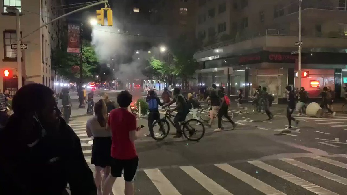 Manhattan ablaze.  My old neighborhood. This is so surreal. The West Village. NYC. Saturday night.