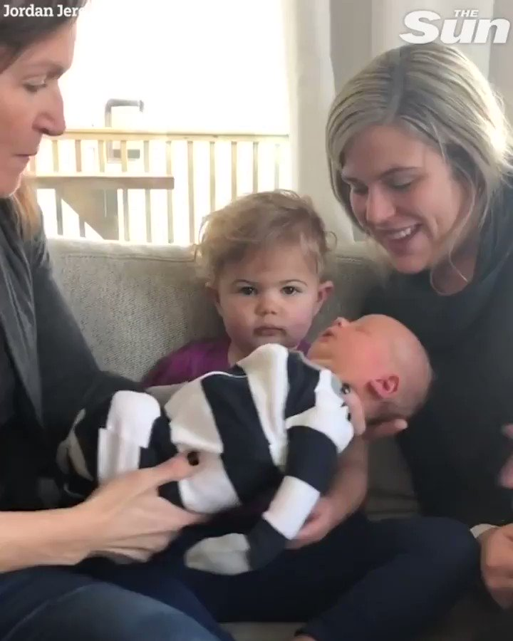 This toddler is not too thrilled to meet her baby brother...