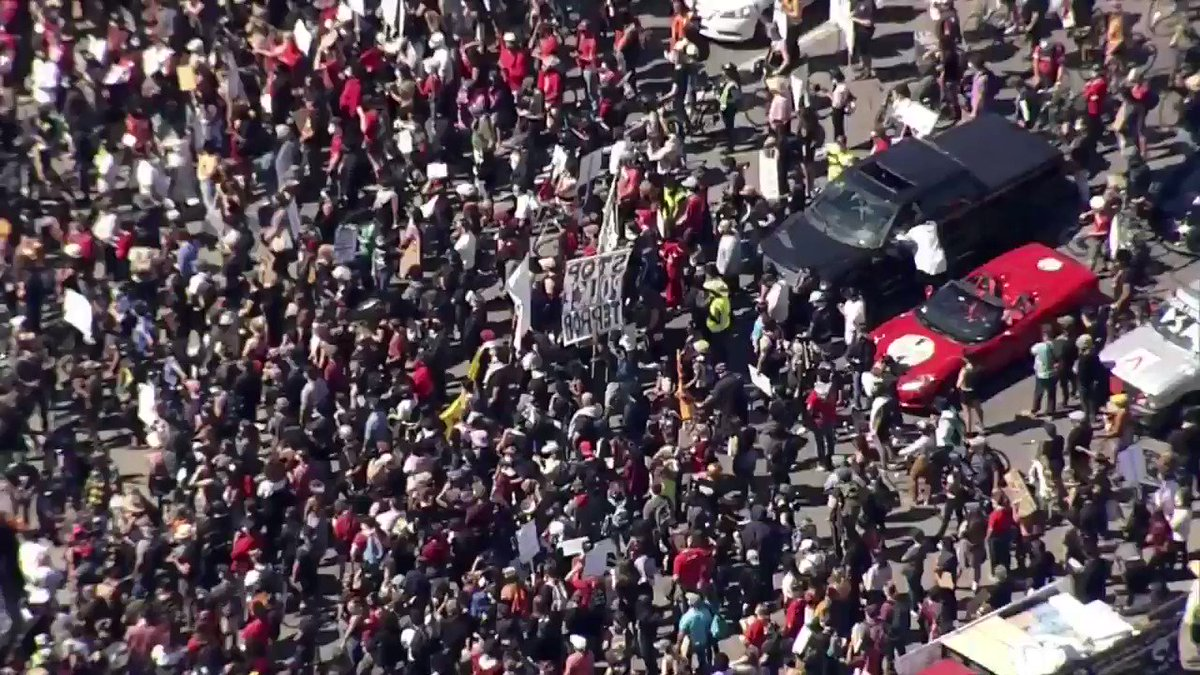 Incredible scene right now as protesters shut down the port of Oakland.