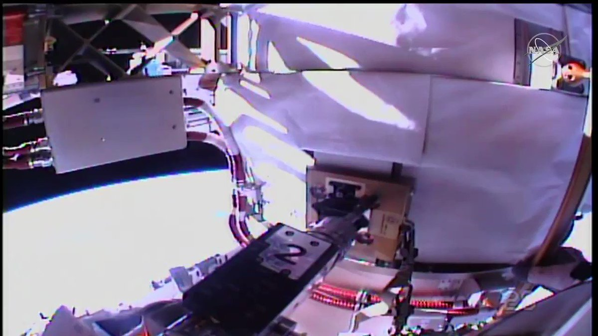 """With today's battery swaps now complete, @AstroBehnken is removing a device called an """"H-fixture,"""" located at the base of the @Space_Station's solar arrays. Meanwhile, @Astro_SEAL is installing a power cable."""