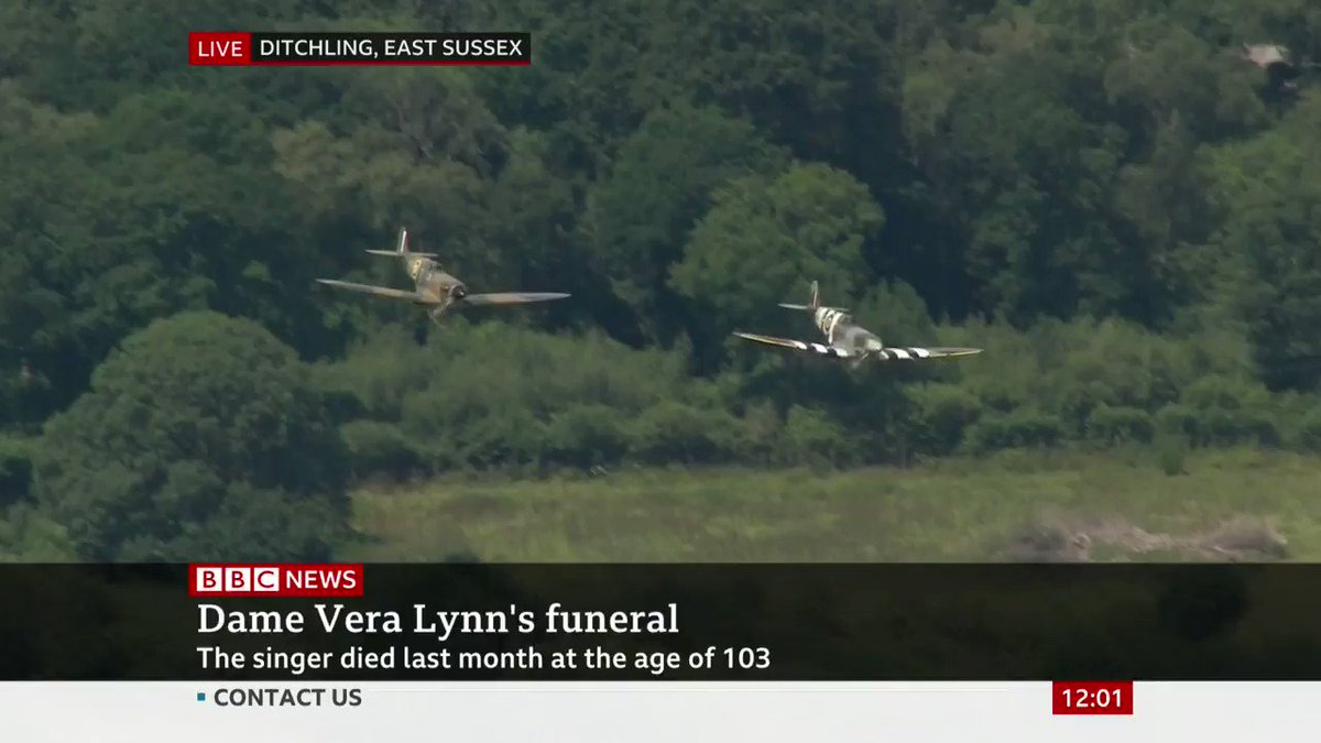 Battle of Britain flypast by two Spitfires accompany Dame Vera Lynn's funeral procession through Ditchling, East Sussex