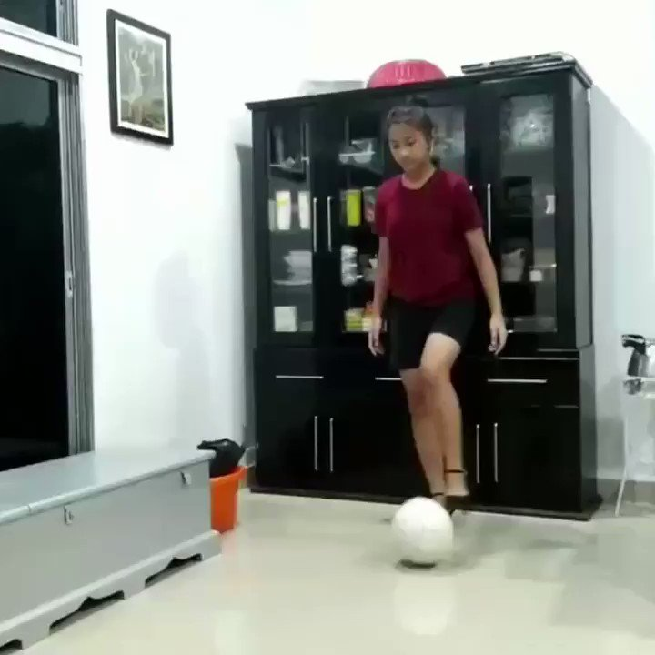 Girl Juggles Football While Wearing High Heels