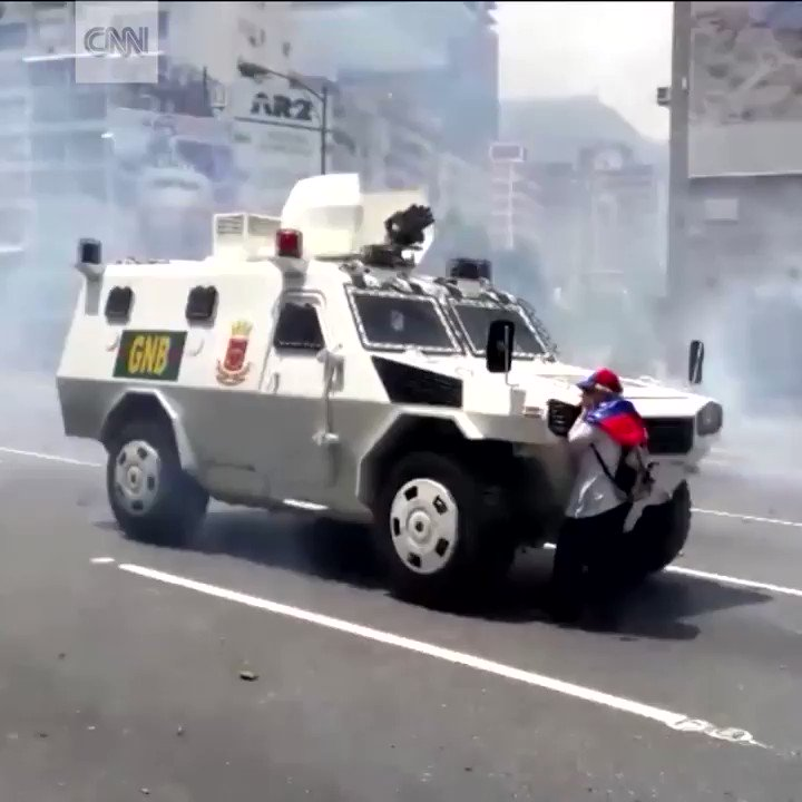 Woman stands down armored vehicle amid protests in the streets of Caracas, Venezuela https://t.co/t6O0i2OQlV