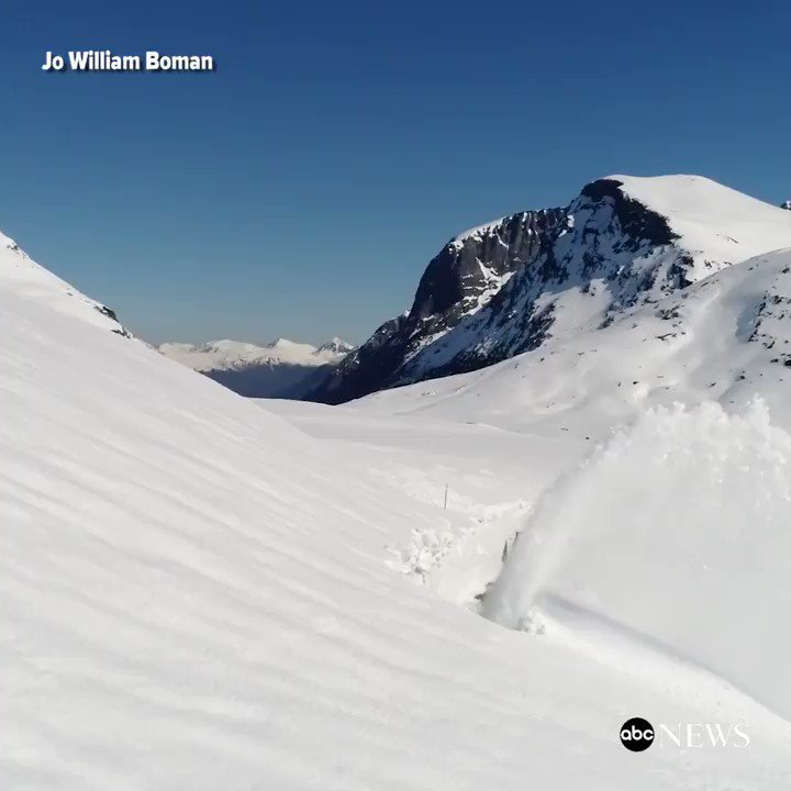 Mesmerizing drone footage shows snow being cleared from Norway's Trollstigen Mountain.
