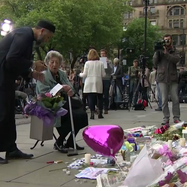 Muslim man and Jewish woman pray together at Manchester memorial