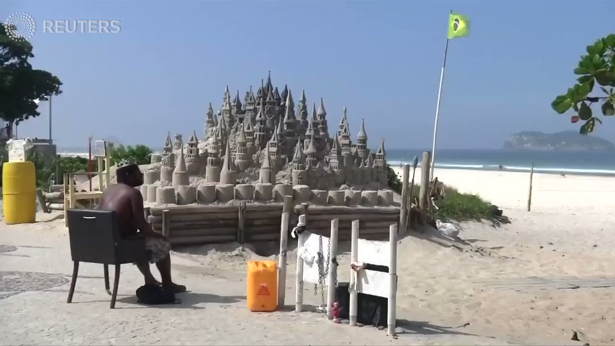 A man's home is his sandcastle in Rio https://t.co/a6m0A3EnB4
