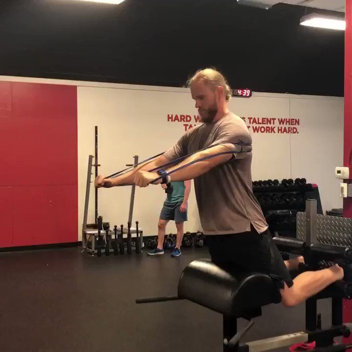 """Glute-ham raise w/banded reach to train scapular upward rotation while working posterior chain. Serratus anterior works like an """"anti-lat,"""" so this setup keeps athletes honest: can't cheat concentric by moving through lumbar extension instead of hip extension. @Noahsyndergaard https://t.co/hBojX5nHlr"""