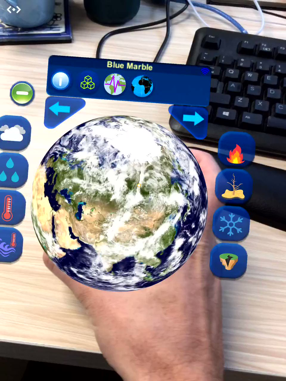 I have just come across #Hologlobe iPad app.  Realtime data displayed on a globe using @MergeVR  - fires, earthquakes, precipitation and more. Great tool for #HowTheWorldWorks. #ESFInnovation https://t.co/CRQK1oHh5O