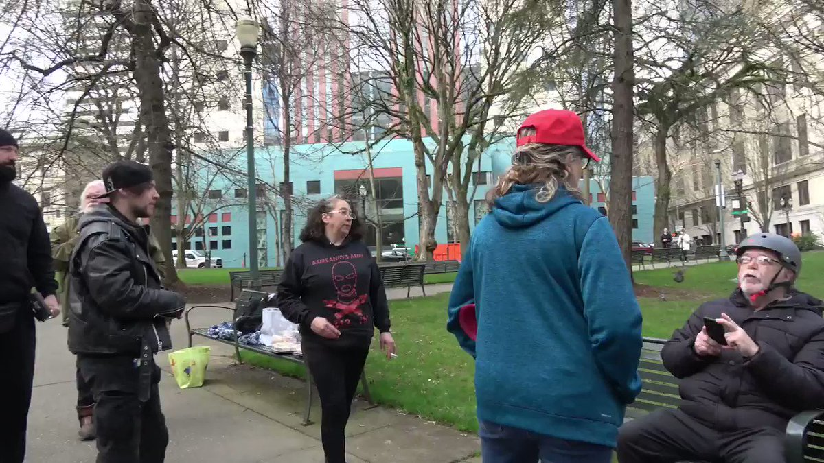 At a Portland rally against antifa, Laura Kealiher, mother of deceased antifa militant Sean Kealiher, got into a fight with a Trump supporter. Sean was killed in mysterious circumstances last year. He had used aliases online to urge terror attacks on schools & law enforcement.