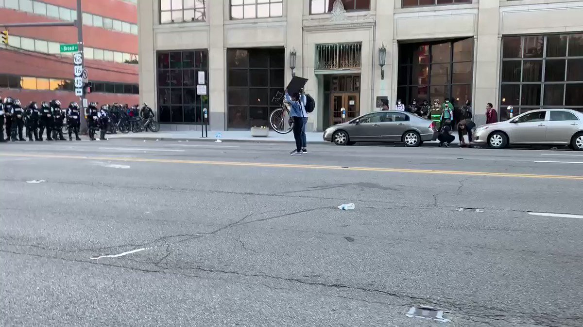The moment a line of U.S. security forces act as a firing squad to shoot a small young woman holding an anti-street execution sign. They don't care if you are peaceful.  #ICanBreathe #GeorgeFloyd #BlackLivesMatter