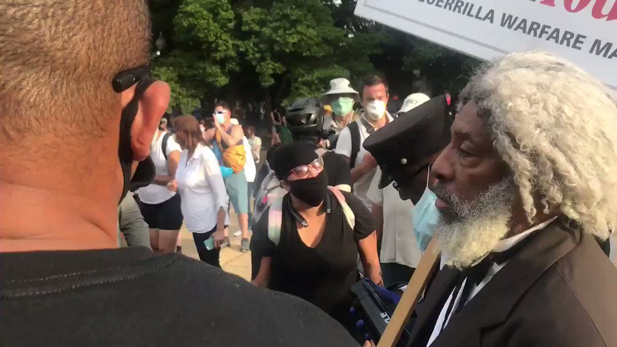 """""""Why are you protecting it?!""""  BLM activist gets into a verbal exchange with an older black guy who was speaking up against tearing the statue down. #emancipationstatue"""
