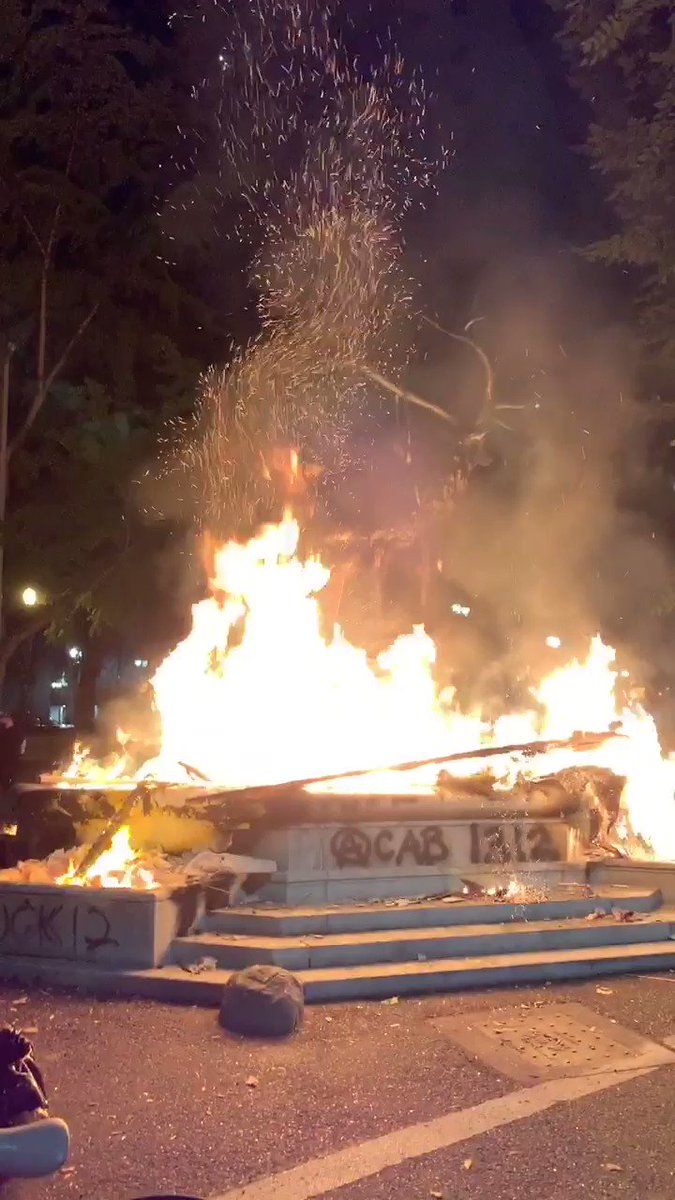 The elk statue in downtown Portland is now fully engulfed in flames. #antifa