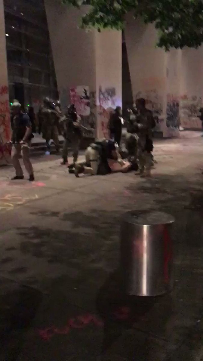 The US military is protecting the Portland federal courthouse under attack tonight by antifa black bloc militants. They rushed out and made an arrest here. Antifa have been trying to set the building on fire for hours.