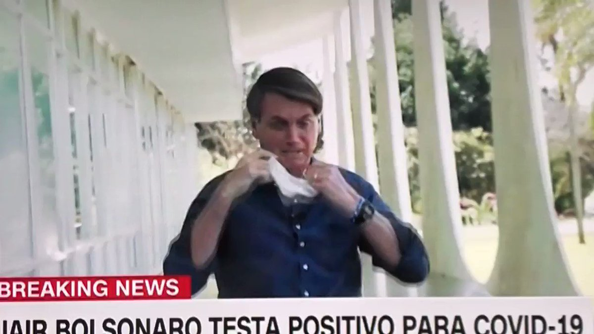 """Just look at my face: I'm fine,"" Bolsonaro says, taking off his mask in front of journalists after announcing he has just tested positive for coronavirus"