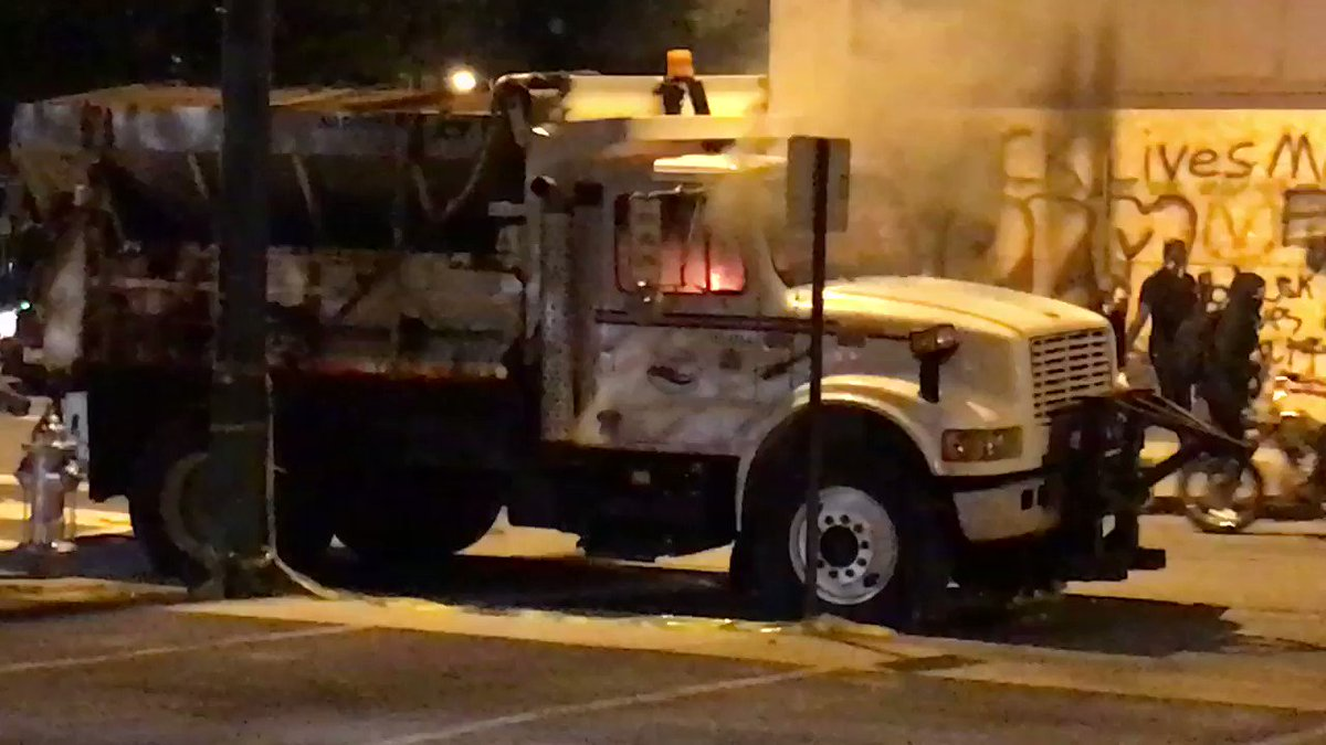 Someone smashed the windows on dump truck and set it on fire.