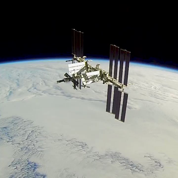 The International Space Station over the Earth as seen by an approaching spacecraft.
