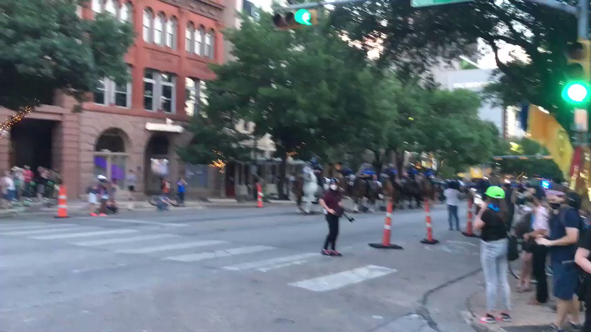 At the antifa gathering in Austin, Texas, militants refuse to disperse occupied streets. Officers move in on horses and forcibly move the people out of the road. They scream and shout in anger. #AustinRiots #antifa