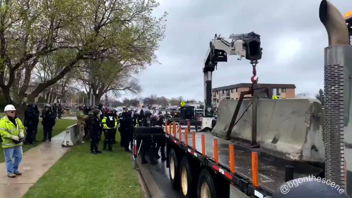Despite curfew being enacted across several counties in one hour, concrete barriers are going up around Brooklyn Center PD. We also hear that Edina PD has fortified a barrier, and several businesses in #Minneapolis & #StPaul have newly boarded up today.