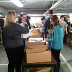 This morning AOTA staff members, friends, and family are stuffing 8,000 totes for #aota15. Its a team effort! http://t.co/sAWQtKG0Nb