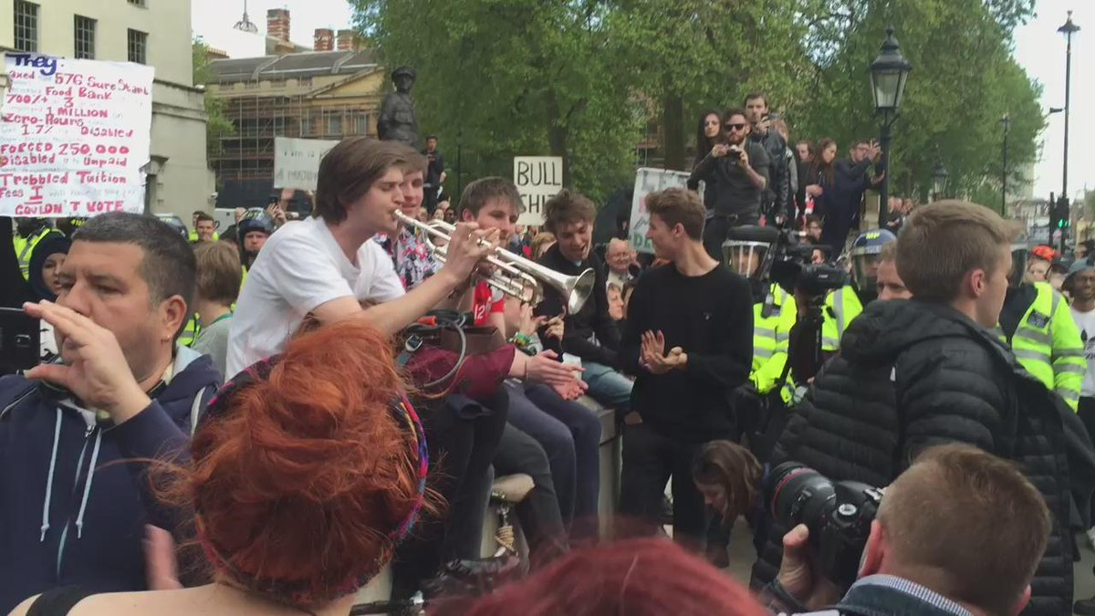 Live music really does change the atmos at a demo. Downing St http://t.co/GKotAdWNVA