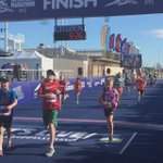 The 2km dash kids sprint to the finish line! #GoldCoast http://t.co/5JZHK9Svgi http://t.co/szKOsEgaCJ
