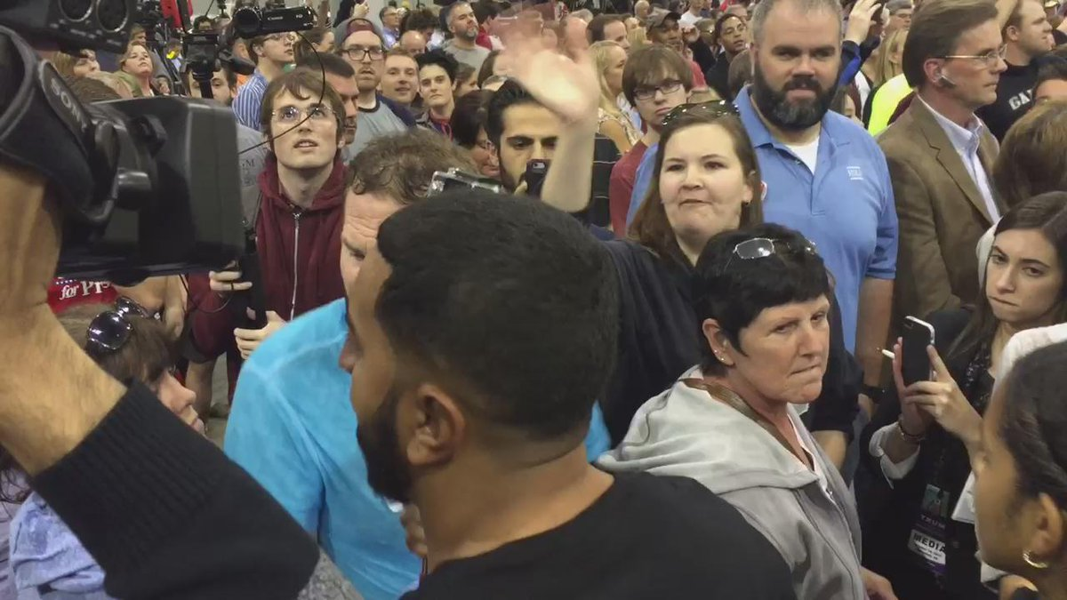 Immigration activists disrupt Trump rally. He gamely continues, but crowd raged. One spit on protestors @wusa9 http://t.co/82T2s845Eu