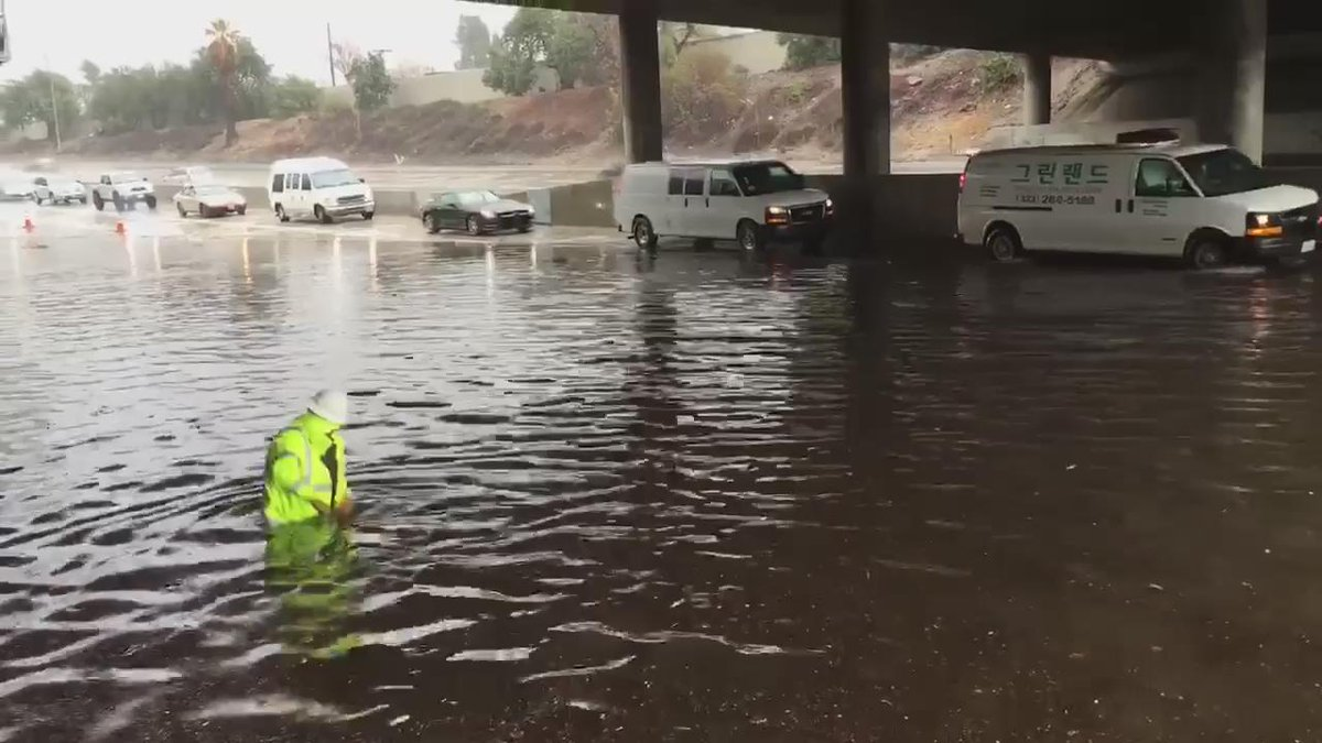 Take a look @CaltransDist7 in waist deep water earlier today trying to clear up drains. Thanks @CaltransDist7! https://t.co/mnuny5v0BT