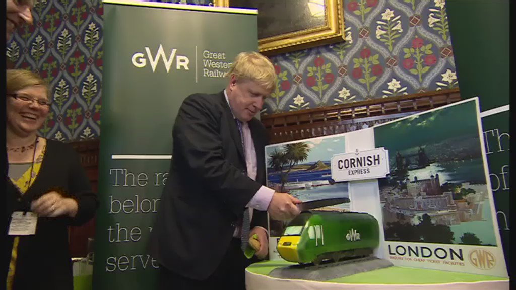 Mayor of London Boris Johnson struggles with a train-shaped cake @BBCNews thanks to @bbcmartynoates https://t.co/eoQeScXb7v