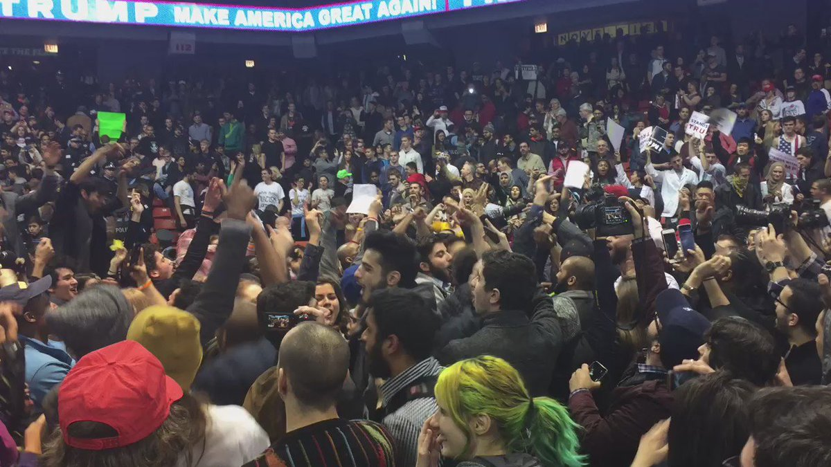 "#TrumpRally protesters chant ""We gonna be alright"" after announcement of a Trump no-show. https://t.co/FXce08oWzI"