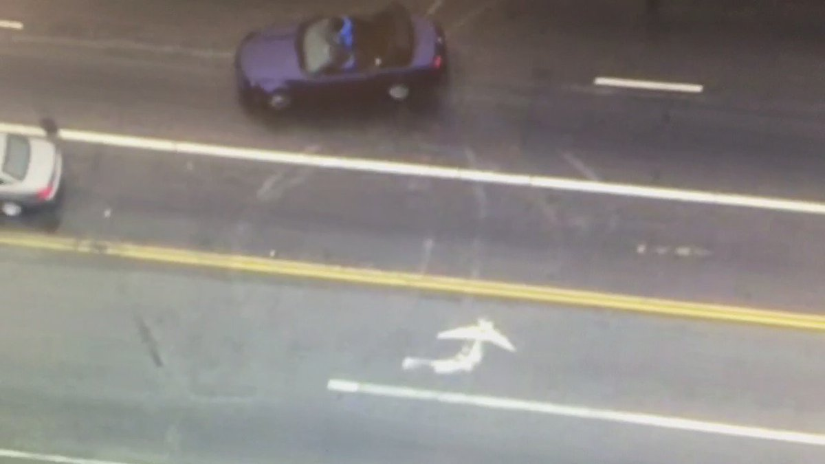 Burglary suspect in convertible doing donuts in Hollywood during police chase.