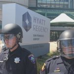 Police from all over the Bay Area line up outside Hyatt during Republican Convention. #donaldtrump protest https://t.co/TJDfA2gdTi