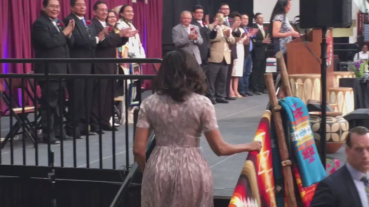 @MichelleObama takes stage at Santa Fe Indian School commencement! Historic moment for these students! #thanksFLOTUS https://t.co/k8MZkZaYKp