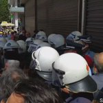 Tension  between dockworkers on #strike and riot police outside hotel where port shareholders meet.  #Greece https://t.co/2QvXYKRheW