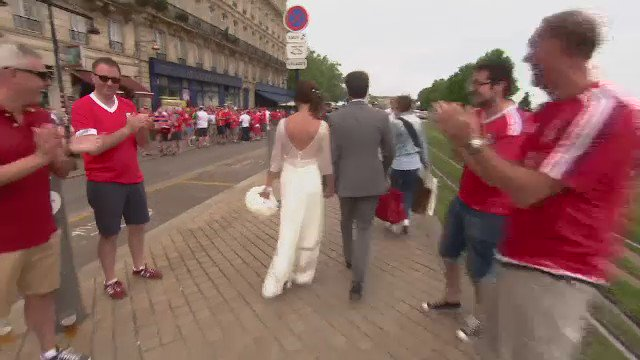 Wales fans in good spirits in Bordeaux - here's a few congratulating a couple on their wedding day! #Euro2016 https://t.co/8Vce2YMy3O