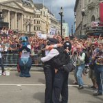 These two policemen proposed on @LondonLGBTPride Parade at Eros statue. One went down on his knee & offered a ring. https://t.co/fGT6bzzh7O