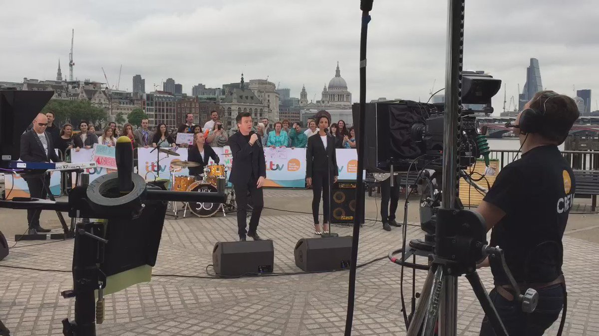 Bloody hell, I am impressed: @rickastley singing live on the Thames at 7am: sounding good, looking good