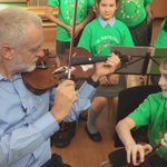 "Corbyn given a lesson in harmony and maths by Jessica, 10. Told ""play that four times"". He plays it five. https://t.co/LmYyUwXh8W"
