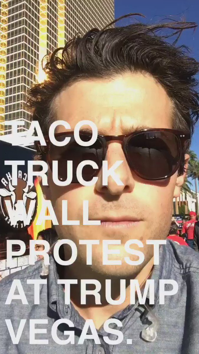 "Protestors outside @realDonaldTrump's Vegas hotel have built a ""taco truck wall."""