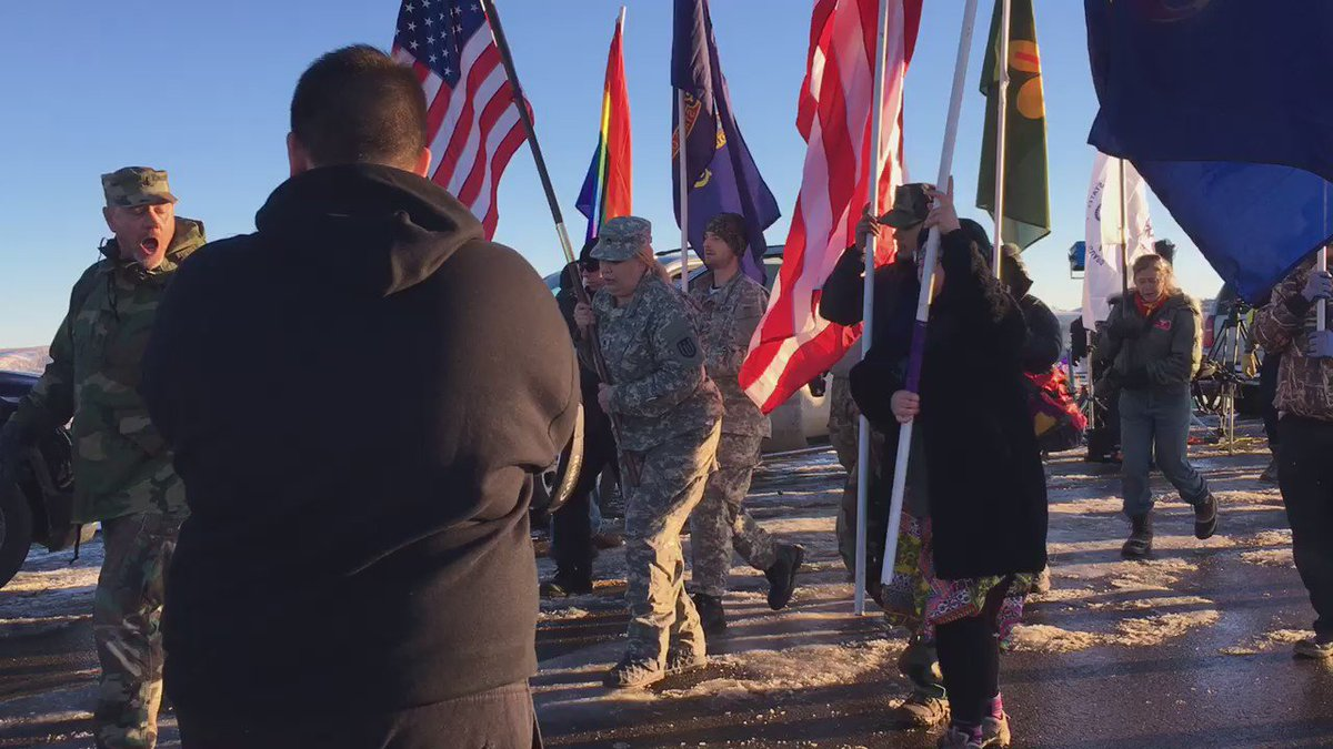 Vets arm and arm with the tribe. #Standingrock #OcetiSakowin https://t.co/G2H2Wa0fGS