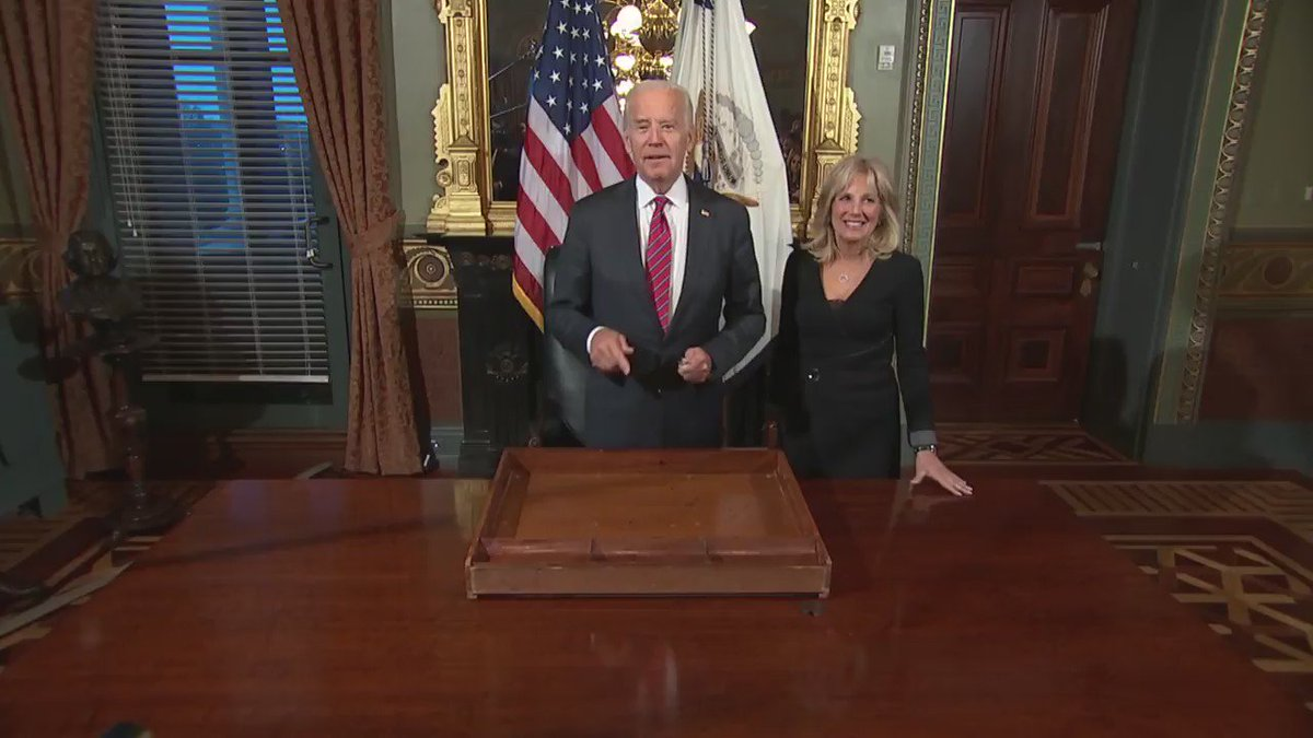 Joe Biden signs his ceremonial desk drawer in one of his final acts as vice president