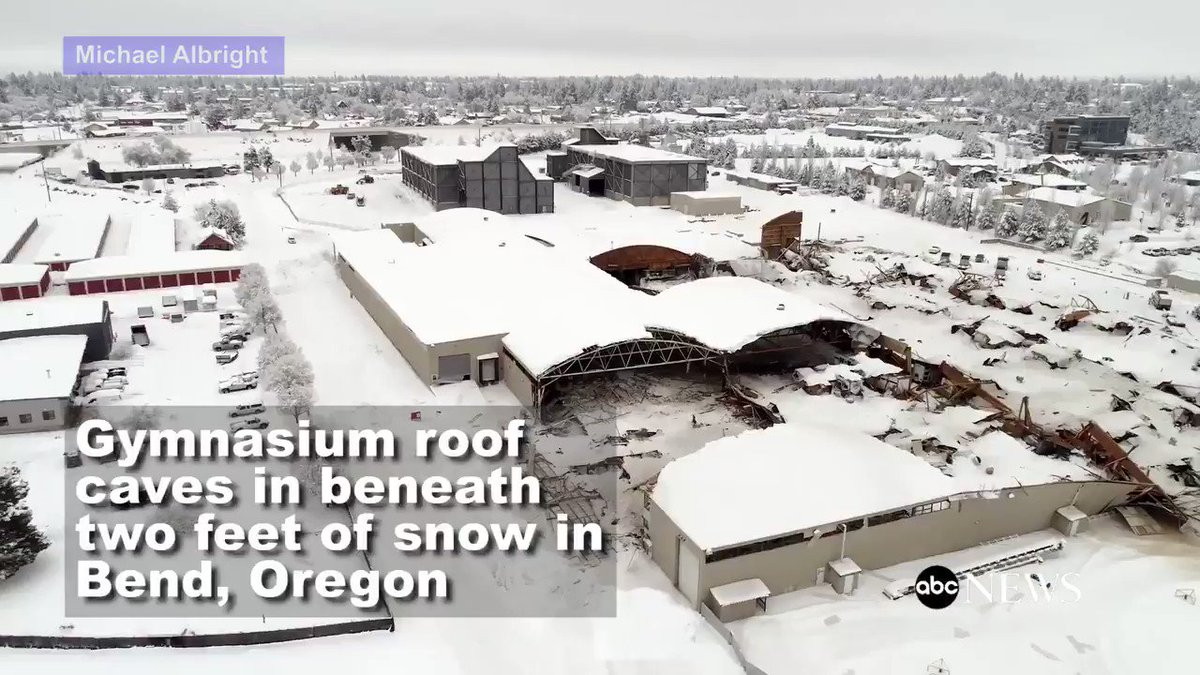 Footage shows gymnasium roof caved in beneath two feet of snow in Bend, Oregon.