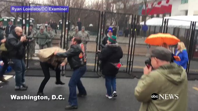 Fistfight breaks out between biker, protester outside a checkpoint for the #inauguration. https://t.co/aemExO5jX3