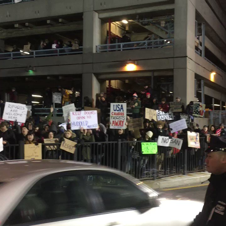 'This shit is illegal, I-L-L-E-G-A-L' hundreds chanting now @ #JFK #NoBanNoWall #RefugeesWelcome https://t.co/Kk3zMGr3OM