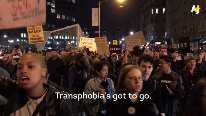 Protesters at Stonewall National Monument march against Trump's recent action against transgender rights.