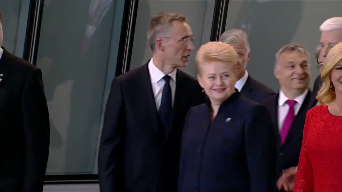 WATCH Pres. Trump places hand on fellow NATO leader and moves him aside to return to front of group of leaders.