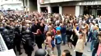 VIDEO Peaceful voters sing--and are then attacked by Spanish police in today's independence referendum #Catalonia