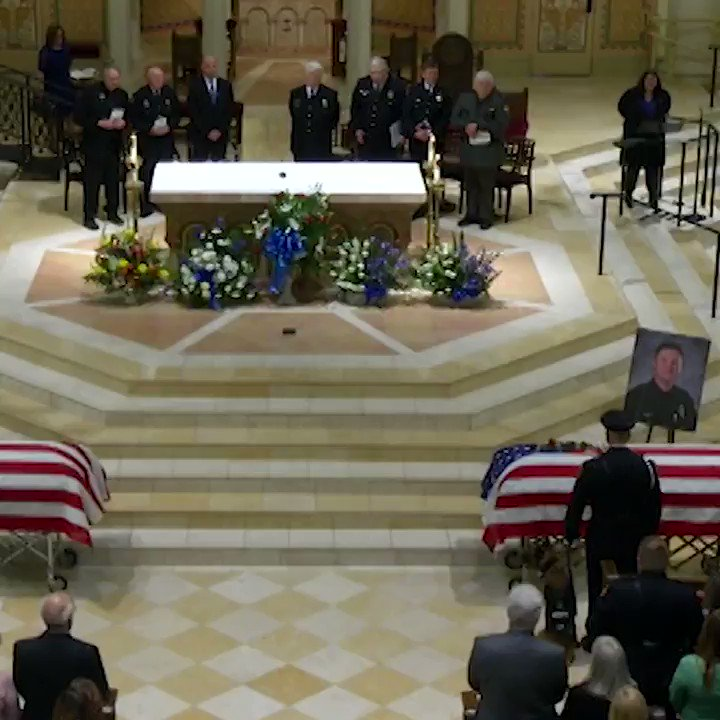 Slain officers remembered as heroes who helped community